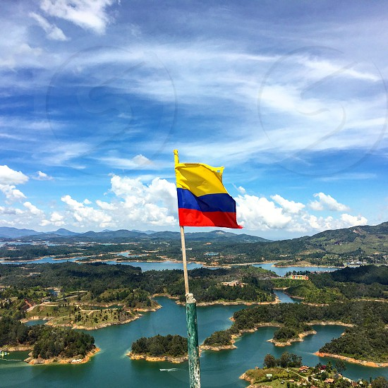 Columbia Colombia Guatape South America Latin America Travel Global Water Landscape Flag Flag Pole By Alicia S Photo Stock Snapwire