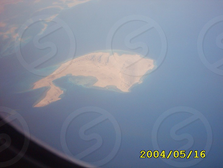 this photo from the plane to the island in the redsea photo