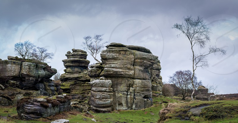 Grit rock outcrop at historical Brimham Rocks on Brimham moor near Pateley Bridge in Yorkshire photo