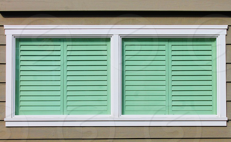 A matching pair of shuttered windows photo