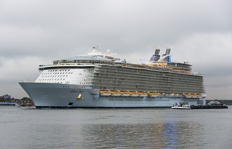 ROTTERDAMNETHERLANDS - OKT 14: The oasis of the seas leaving the rotterdam harbor to southampton on Okt 2014 in Rotterdamthis is the biggest cruise ship in the world photo