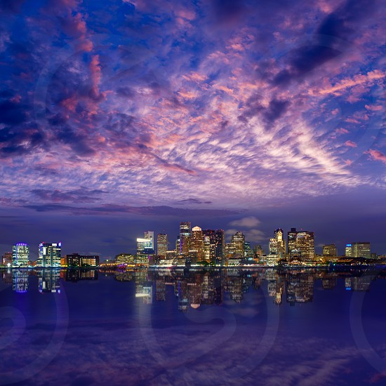 Boston skyline at sunset and river reflection in Massachusetts USA photo