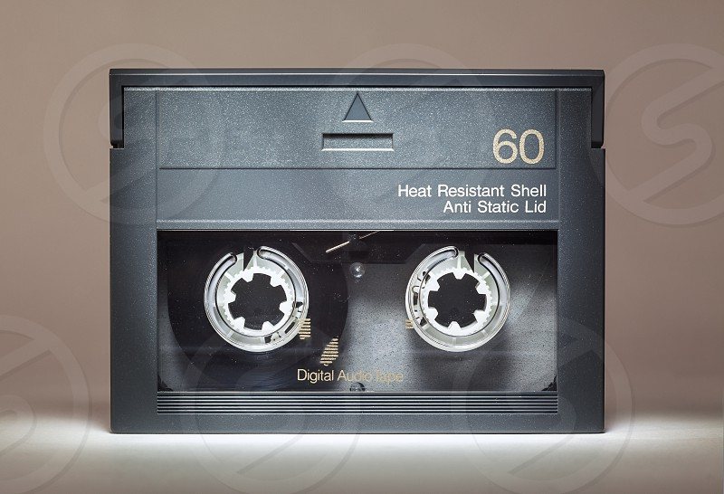 Details of an old dusty digital audio tape retro technology from the 90's.  photo