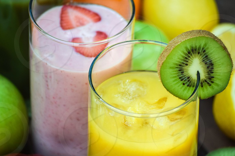 strawberry juice and orange juice with kiwi photo