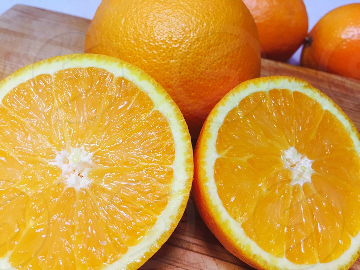 Oranges chopping board  photo