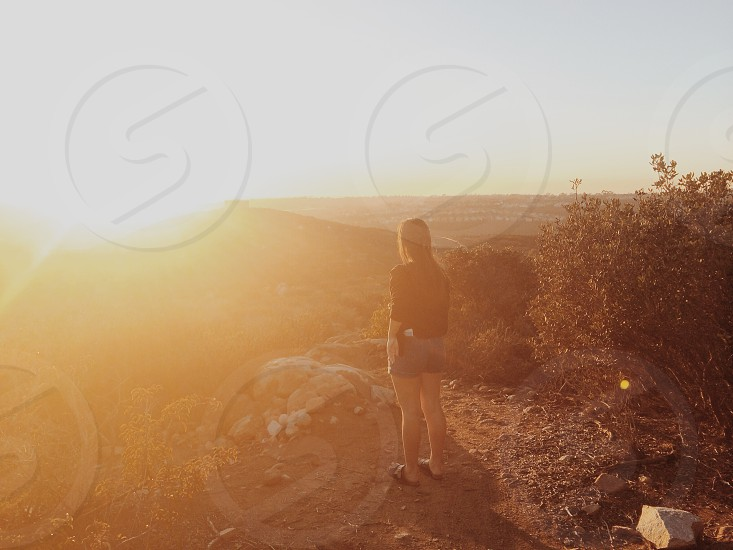 girl standing on mountain photo