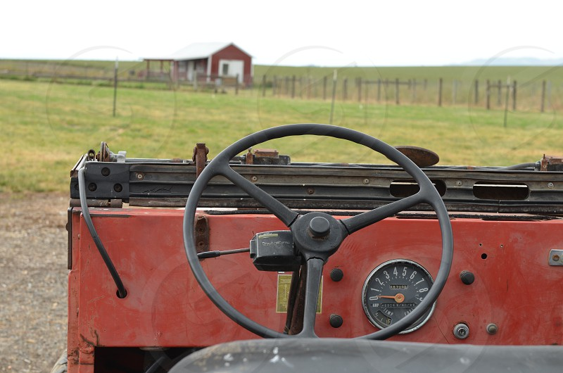 Dashboard view of old truck on farm photo
