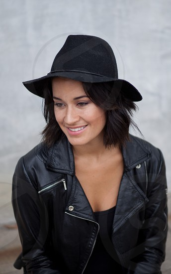 woman in black leather jacket and fedora hat photo