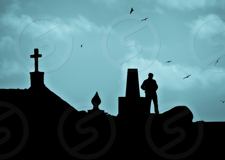 man on top on roof silhouette photo