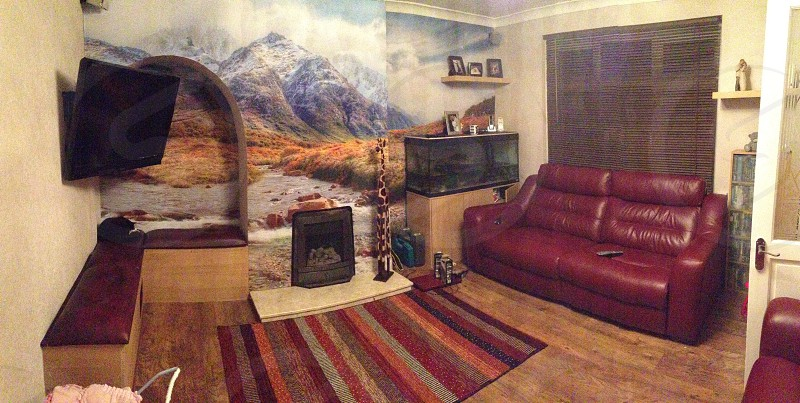 brown leather couch near the window and aquarium photo