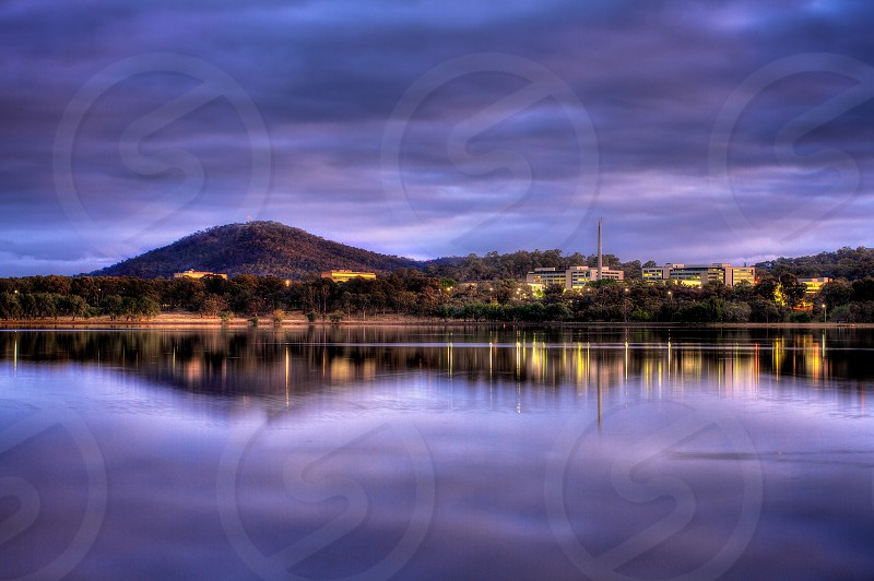 Early morning Canberra reflection. Australia Canberra reflection lake morning early blue purple water clouds calm photo