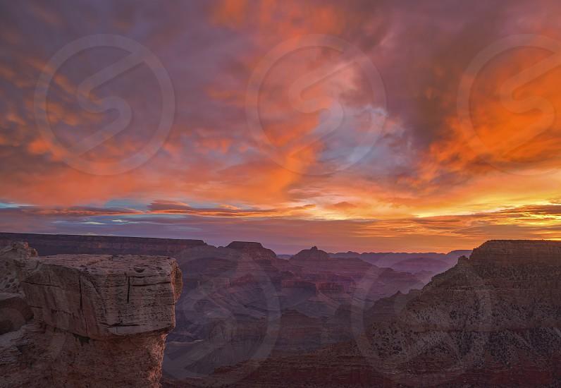 Fiery coral sunrise clouds at Yavapi Point Grand Canyon National Park Arizona photo