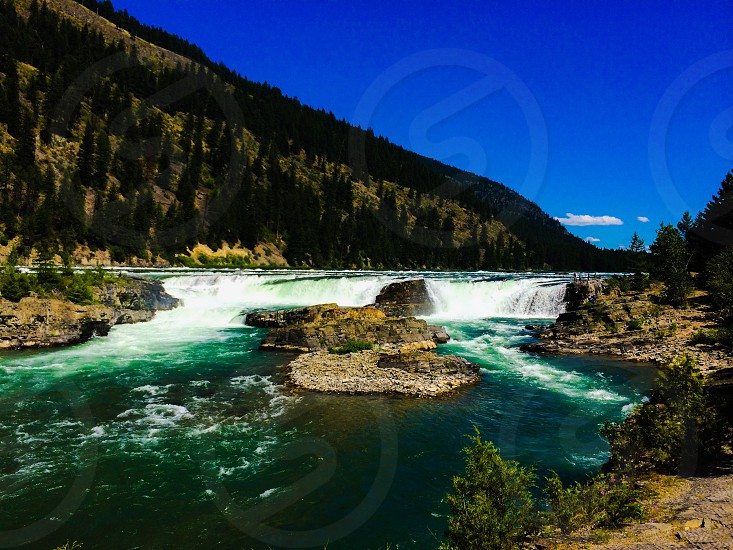 Travel vacation hiking Glacier National Park Montana Going to the sun road scenic waterfalls photo