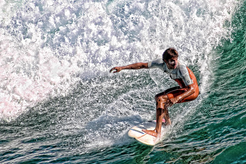 Surfer rides ocean waves photo