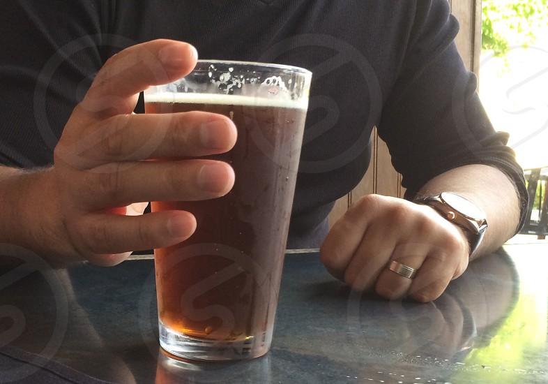 Man male hand beer pint glass photo
