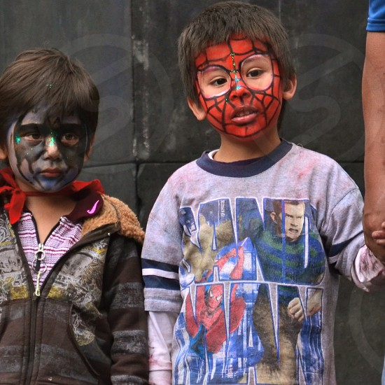 boy wearing red spider-man mask painting photo