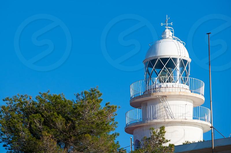 Cabo de San Antonio Cape Lighthouse in Denia Javea of Alicante in Mediterranean Spain photo