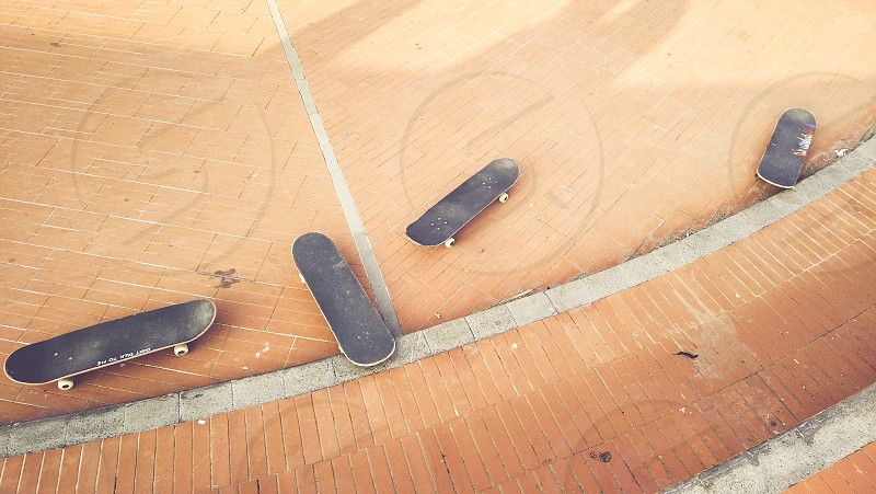 Skateboard on the road used to make fantastic evolutions  photo