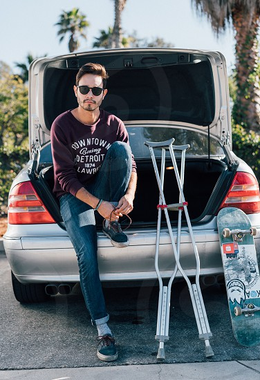 injured man with skateboard photo
