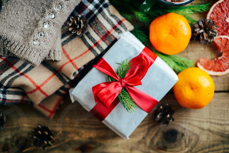 Christmas presents on wooden table. A couple of gifts wrapped in Christmas themed wrapping paper. photo
