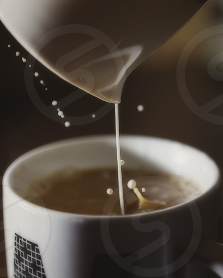 Coffee with a splash of cream.  photo