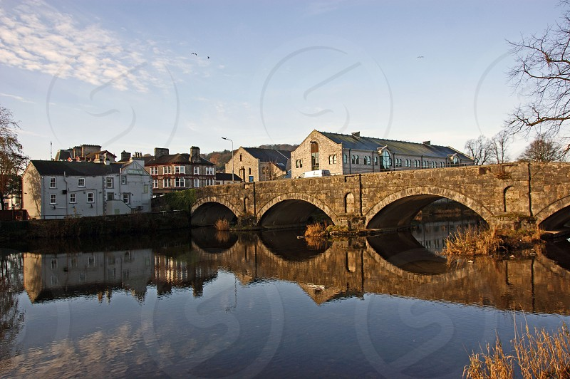 UK. ENGLAND. KENDAL Cumbria. The bridge over the River Kent. photo