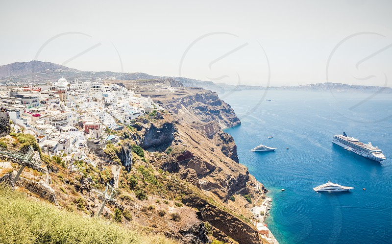 Top View Of The Caldera Cruise Ships And Boats In The Sea On Famous Greek Island Santorini photo