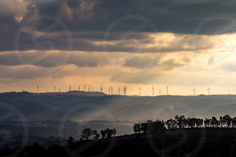 Wind turbines. Wind power generators. Alternative energy reduce global warming. Reduce insufficient energy problems. photo