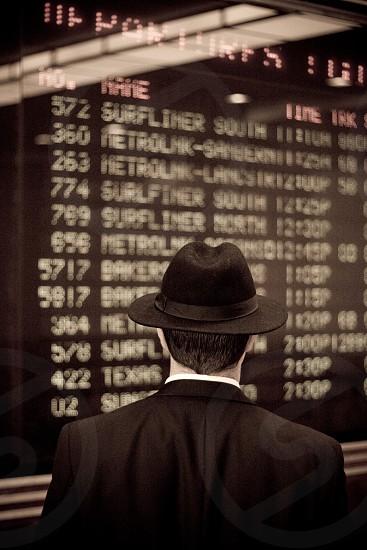 men's black suit with hat photo