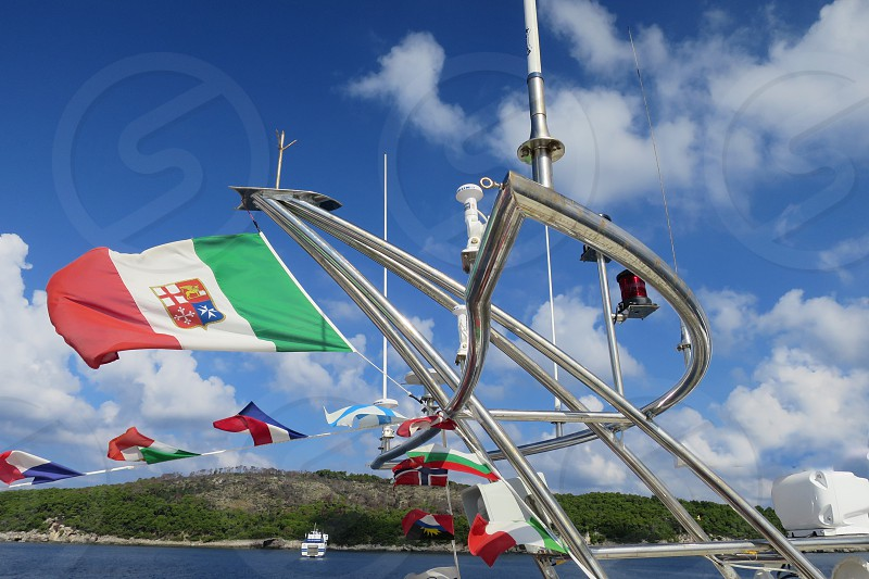 mast of a boat with flag and radar photo