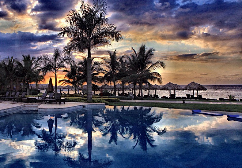 Sunset reflection mirror trees pool tropical beach sea carribean Island Jamaica secrets photo