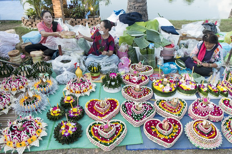 a smal shop with handmade Krathong at the Loy Krathong Festival in the Historical Park in Sukhothai in the Provinz Sukhothai in Thailand.   Thailand Sukhothai November 2018 photo