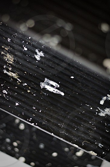 Macro shot of paint splatters on a ladder photo