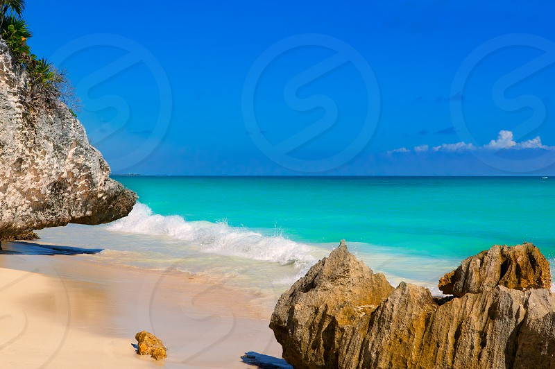 Tulum beach near Cancun turquoise Caribbean water and blue Sky photo