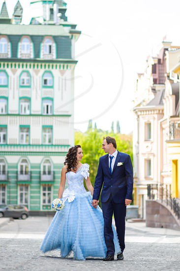 Happy couple in love walking in the city photo