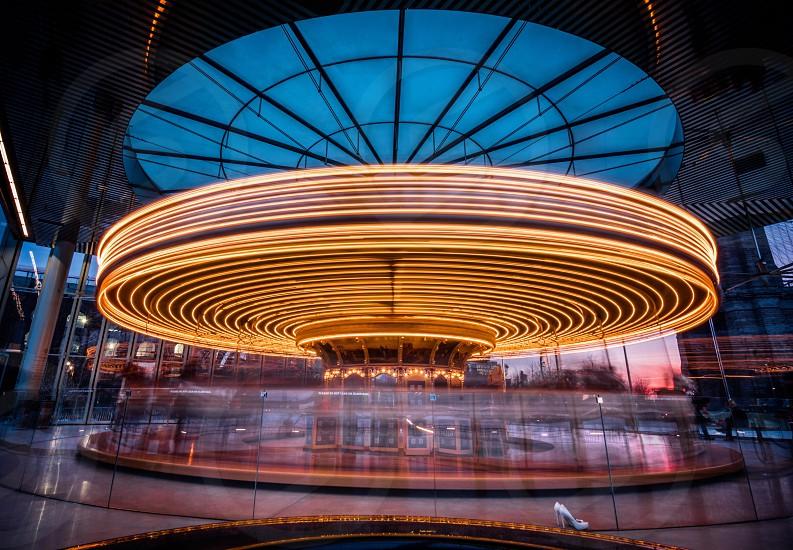 Amusement carousel speed movement Brooklyn New York interior motion merry go round long exposure  photo