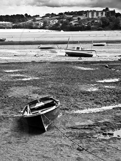 black and white photo of boats on beach photo