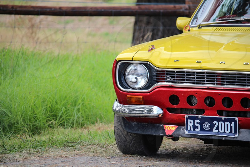 classic yellow and red Ford vehicle photo