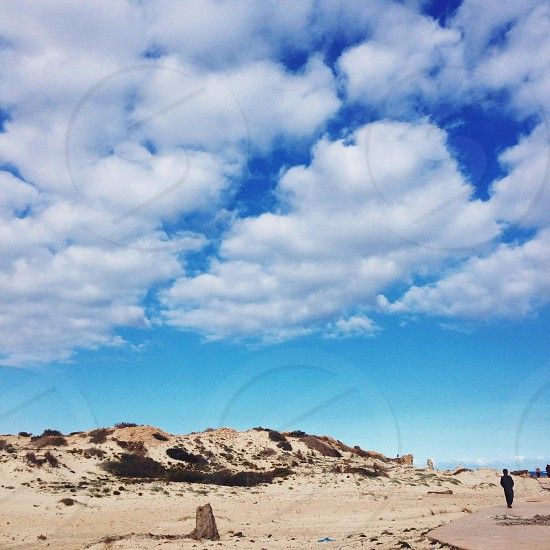rocky mountain on a clear blue sky photo