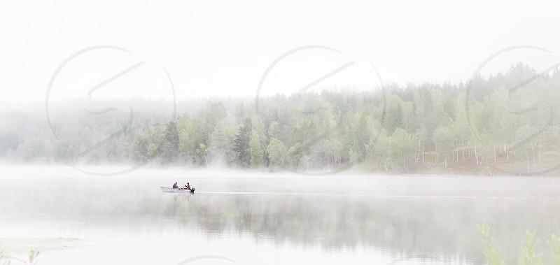 Foggy fog mist lake fishing fishers boat Sweden photo