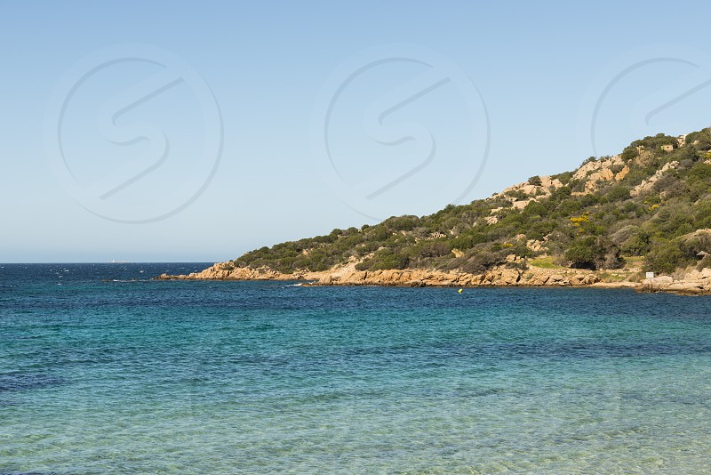 the norht east coastline of sardinia called costa smeralda with blue ocean and beautifull nature photo