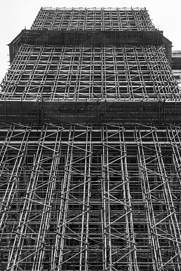 Large mult-story building enclosed by a scaffolding structure photo