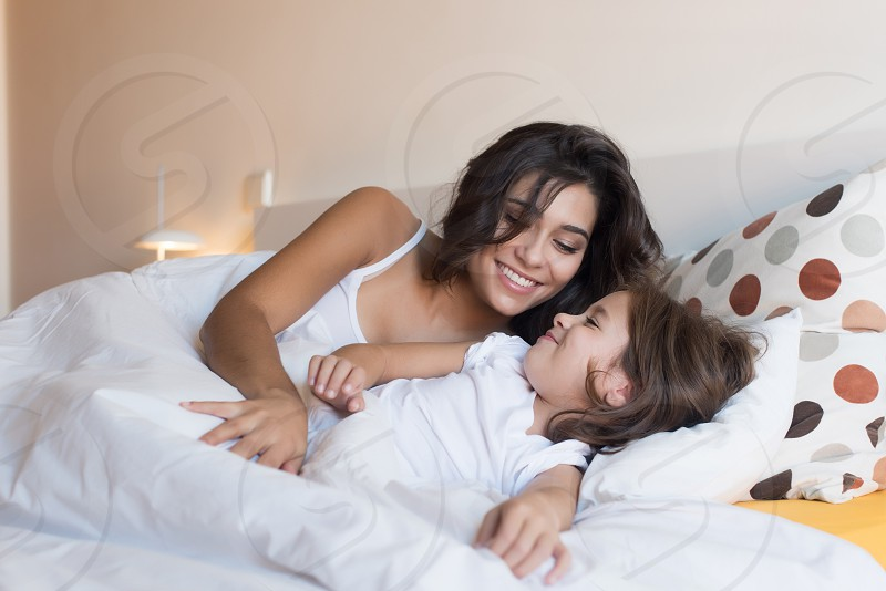 mother's day mother daughter child kid hugging family love bedroom bed morning photo