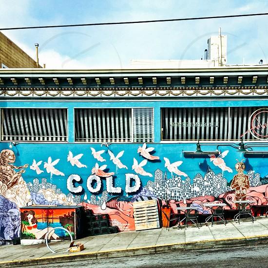 Sidewalk cafe/mural photo