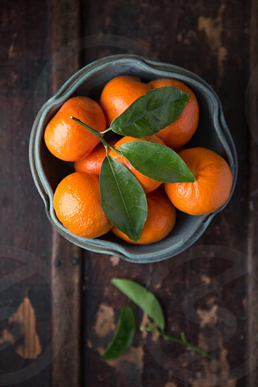 Overhead view of Satsuma Mandarins on a rustic wooden surface photo