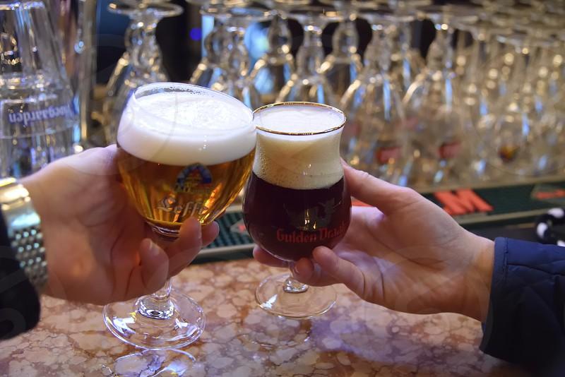 happy hour toast cheers bar glasses foam belgium brews photo
