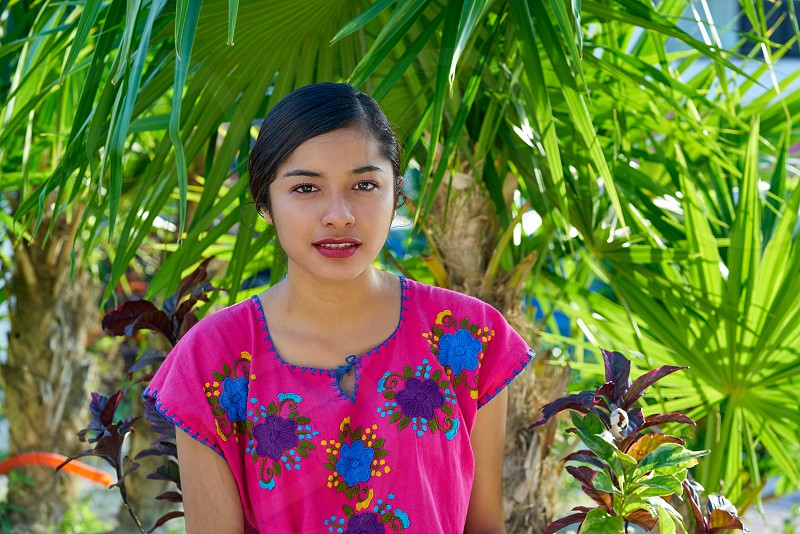 Mexican latin woman with mayan dress in  the jungle photo