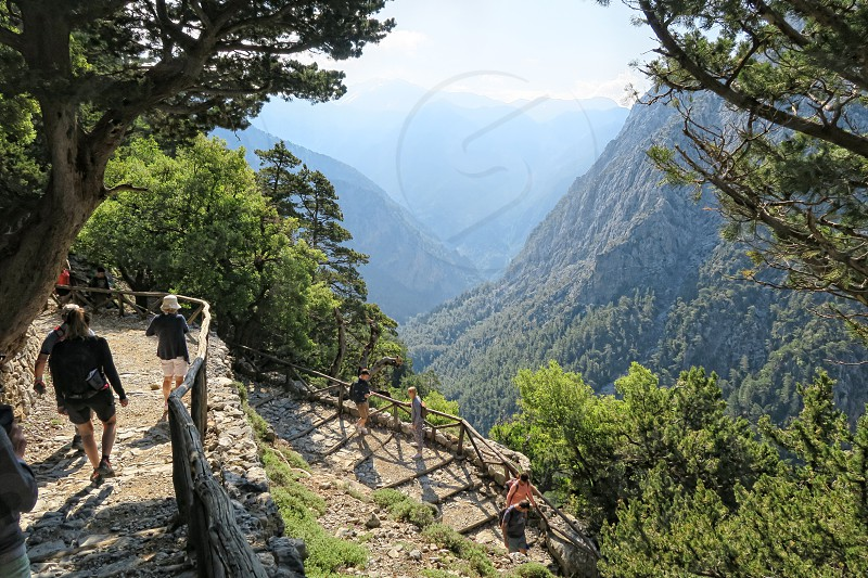 Samaria Crete / GREECE May 25 2017: People hiking on trail through Samaria gorge. (Crete Greece).  photo