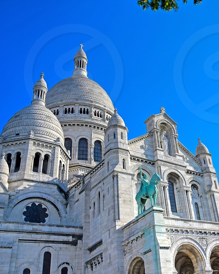 The Basilica of the Sacred Heart of Paris commonly known as Sacré-Cœur Basilica located in the Montmartre district of Paris France. photo