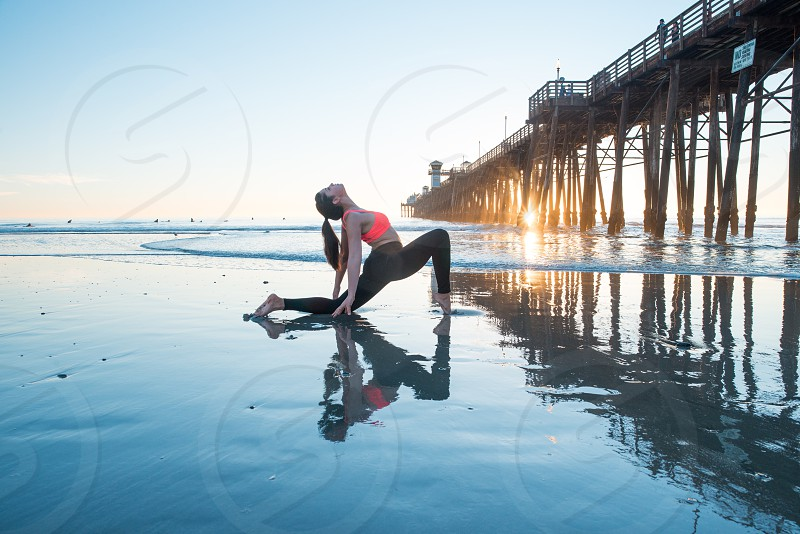 Beach yoga sunset California exercise spiritual stretch  photo